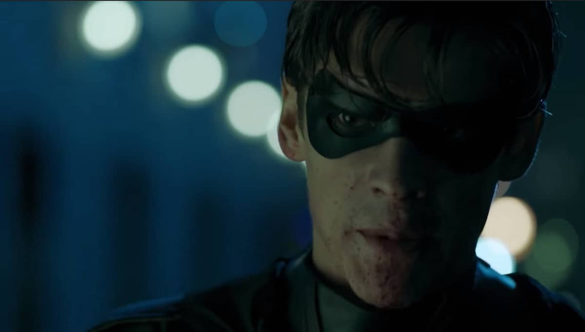 Dick Grayson splattered with Blood after taking down criminals
