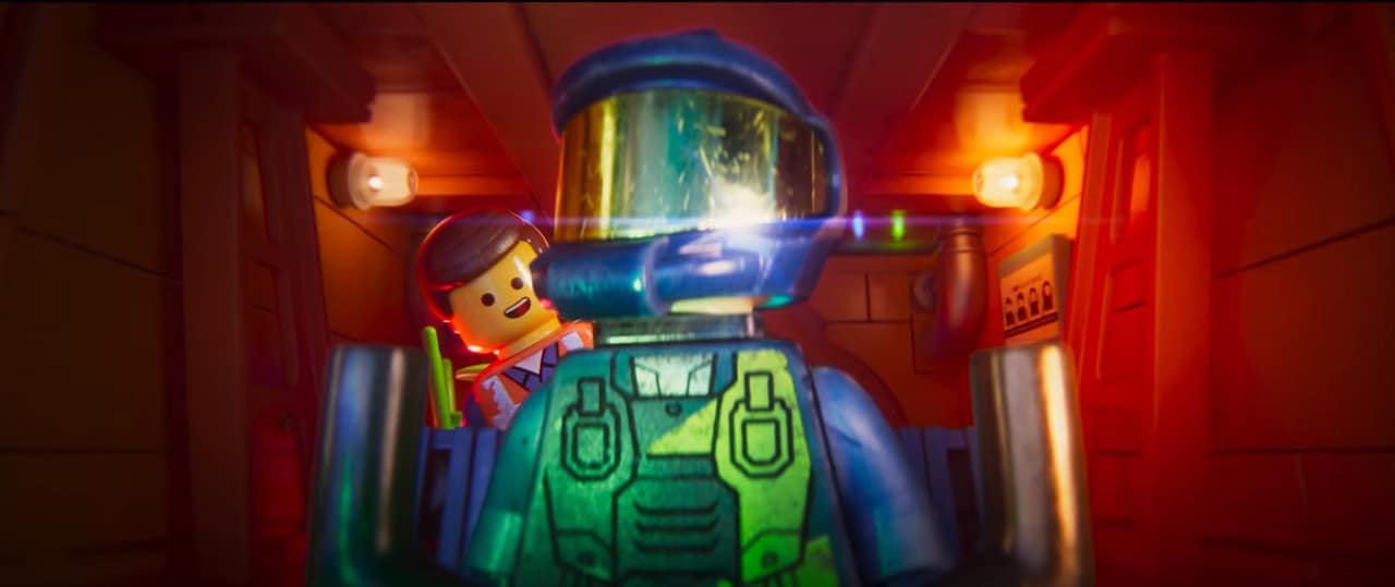 Emmet meets Rex Dangervest: Galaxy defending archaelogist, cowboy, and raptor trainer. Both characters are voiced by Chris Pratt (Image Credits: Warner Bros. Pictures / Lord Miller Productions)