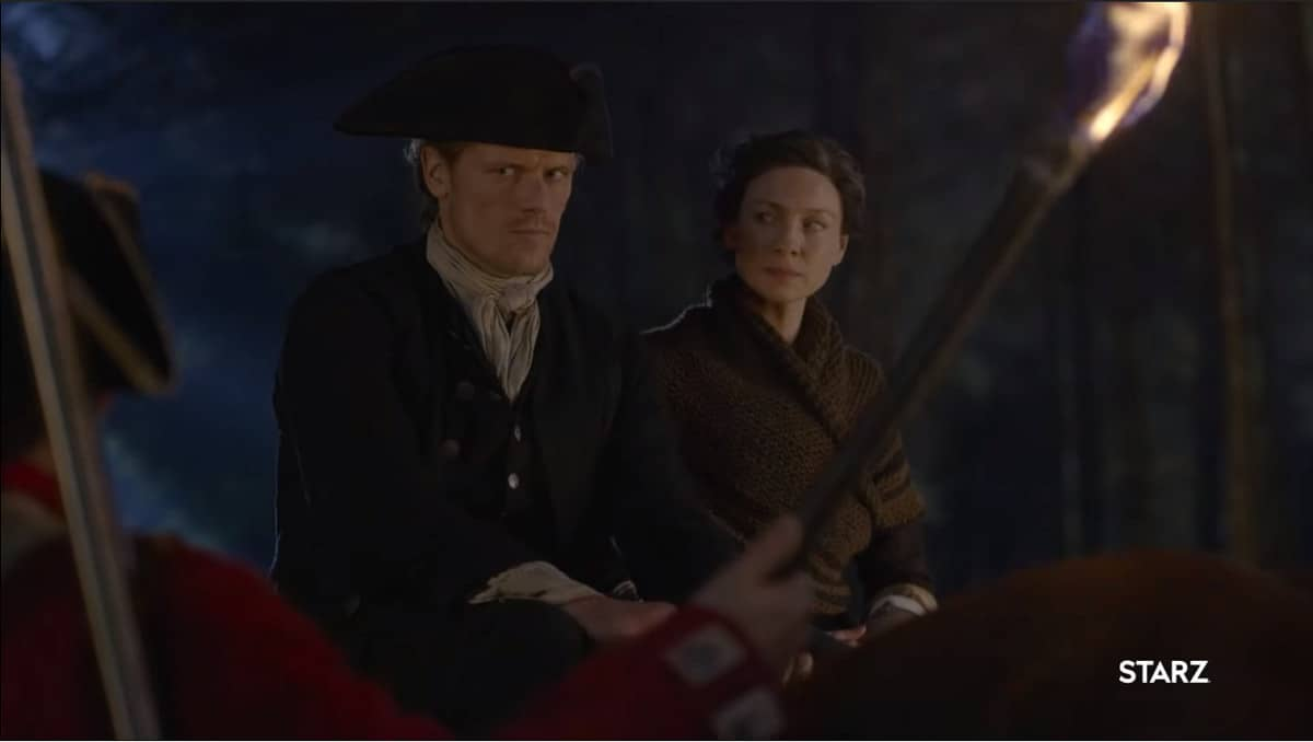 Jamie and Claire are beset by unwelcome company on the road (Image Credits: Starz)