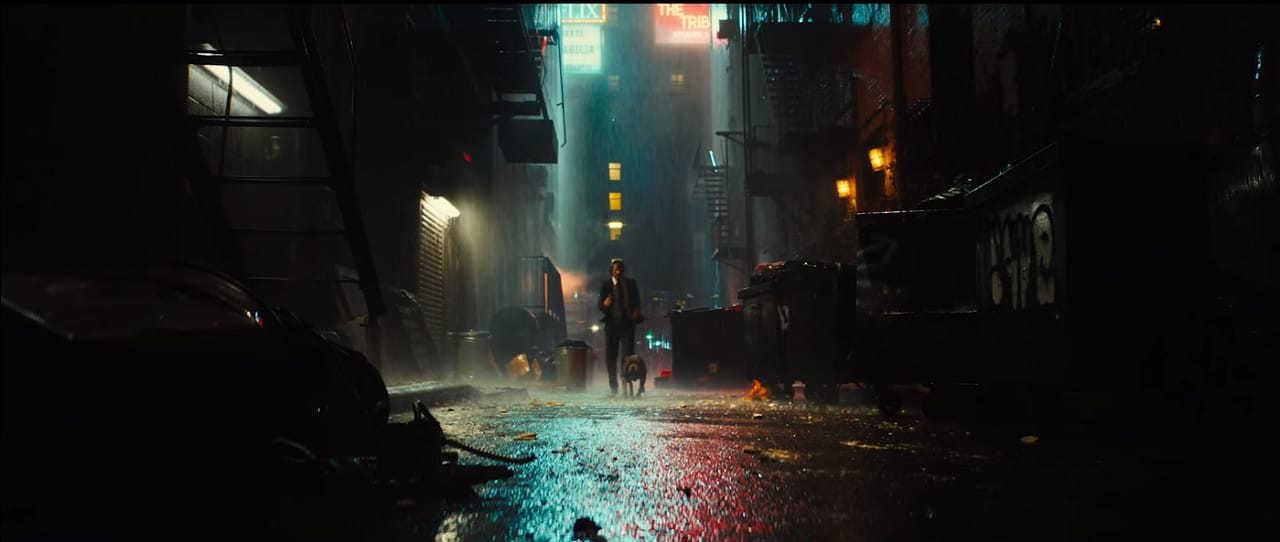 John and his pooch run through the streets (Image Credits: Summit Entertainment / Lionsgate)