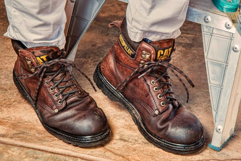 Work boots not worn properly. The exposed laces could easily get caught in machinery and the exposed openings are entry points for foreign objects that can hurt your feet (Image Credits: stevepb / Pixabay)
