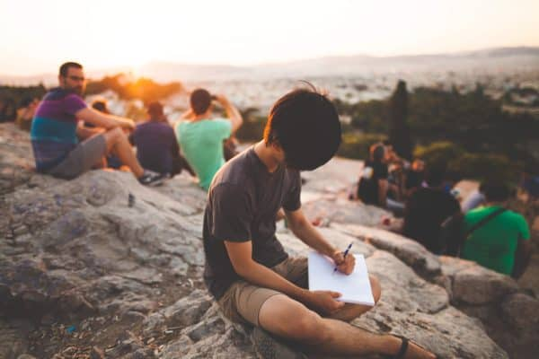 An active man actively writing outdoors (Image Credits: StockSnap / Pixabay)