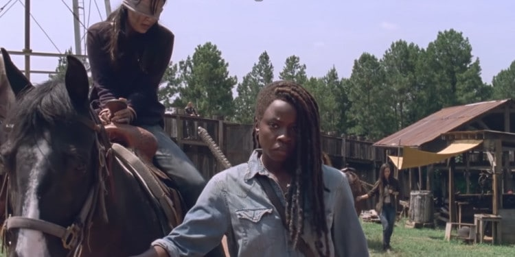 Michonne leading the horse ridden by a captured Lydia, Alpha's daughter (Image Credits: The Walking Dead / Season 9)