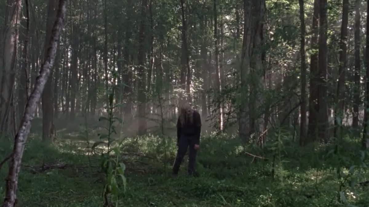 Alpha standing in the middle of the woods (Image Credits: The Walking Dead / Season 9)