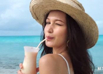 A model slyly winks at the camera while enjoying the Bahamas in Netflix's Documentary (Image Credits: Netflix)