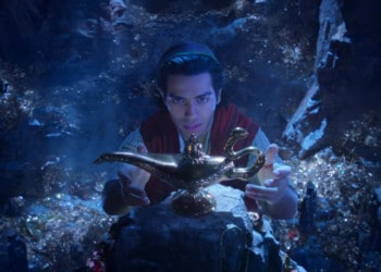 Aladdin reaches for the magic lamp in the cave of wonders (Image Credits: Walt Disney Studios)