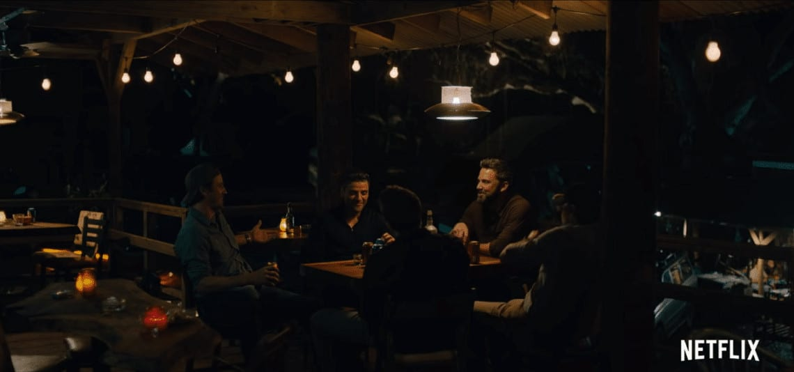 Ben Affleck, Oscar Isaac, Pedro Pascal, Charlie Hunnam, and Garrett Hedlund's characters celebrating their friendship in Netflix's Triple Frontier (Image Credits: Atlas Entertainment / Netflix)
