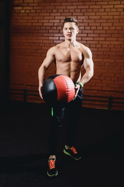 Basically standing russian twists, wall balls are guaranteed to work your obliques