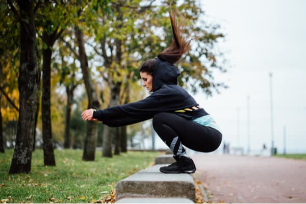 woman doing long jumps